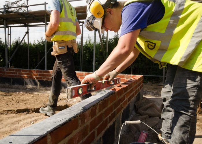 A slate DPC was used to minimise any moisture ingress travelling up from the porous brick.